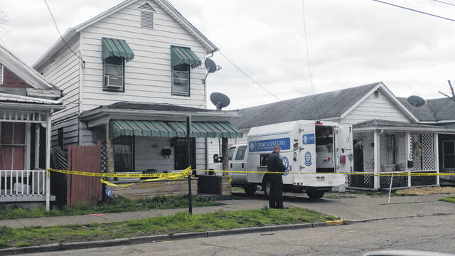 Gallipolis Police Department investigates the death of Tyrone Powell, Jr., in the 700 block of Third Avenue in Gallipolis in this photo taken last month. Reportedly, a 15-year-old male has been charged with aggravated murder in connection with his death.