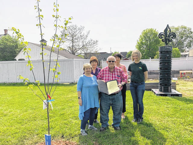 Residents of Gallia recently planted a tree in celebration of Arbor Day in the Gallipolis Community Garden. From left to right are Gallipolis in Bloom's Cathy Waller, Diana Parks, Betty Begrow and Bob's Market's Ashley Riffle. In center is Gallipolis City Commissioner Tony Gallagher who read a proclamation from the city memorializing the day.