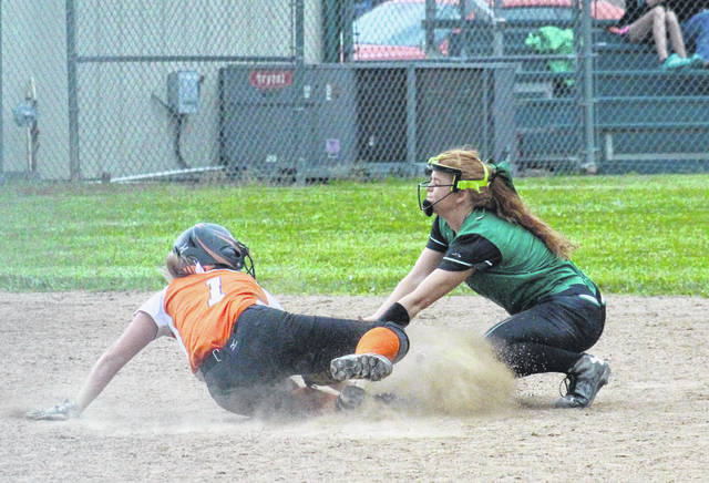 Eastern senior Ally Barber (right) tags a Belpre runner out sliding into second base, during the Lady Eagles' 12-3 victory in the D-4 sectional final on Thursday in Tuppers Plains, Ohio.