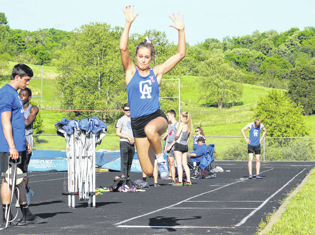 Gallia Academy junior Alex Barnes leaps through the air during an attempt in the long jump event at the 2019 Battle for the Anchor held May 6 at Gallia Academy High School in Centenary, Ohio.