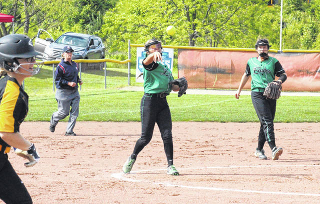 Eastern senior Alexus Metheney (center) throws a runner out at first base in front of classmate Emmalea Durst (right), during the Lady Eagles' 8-3 victory on Tuesday in Rio Grande, Ohio.