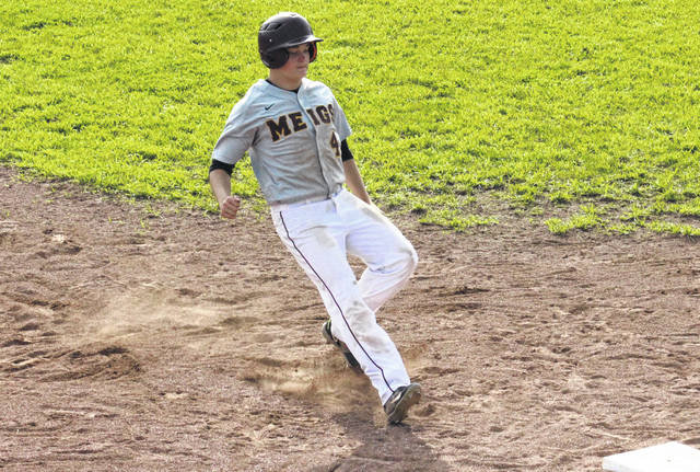 Meigs senior Wesley Smith pulls into third base, during the Marauders' 7-4 setback in the sectional semifinal on Wednesday in Rocksprings, Ohio.