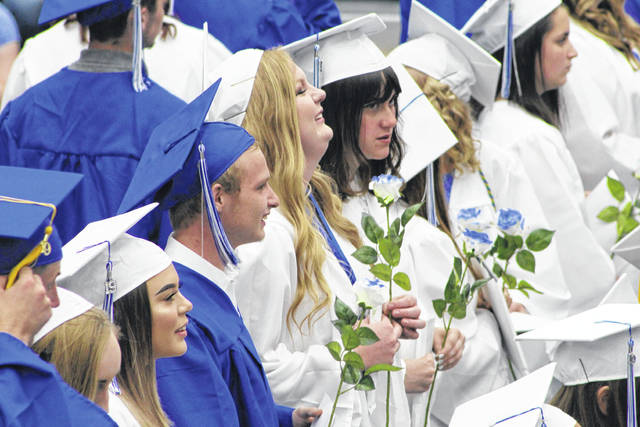 These members of the Gallia Academy High School Class of 2019 take in the first, few moments of being a graduate, with diploma finally in hand.