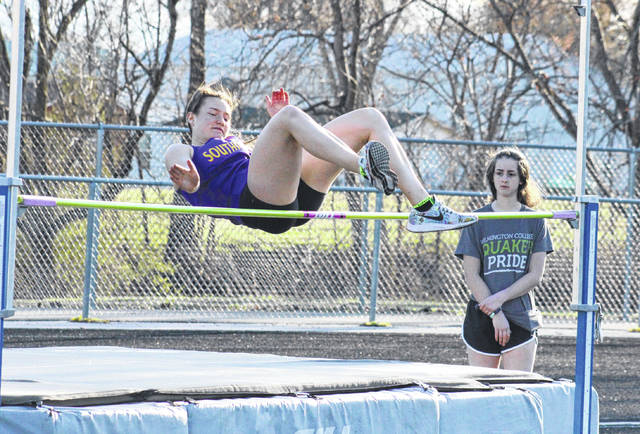 Southern junior Baylee Wolfe clears the bar in the high jump, during the River Valley Open on April 2 in Bidwell, Ohio.