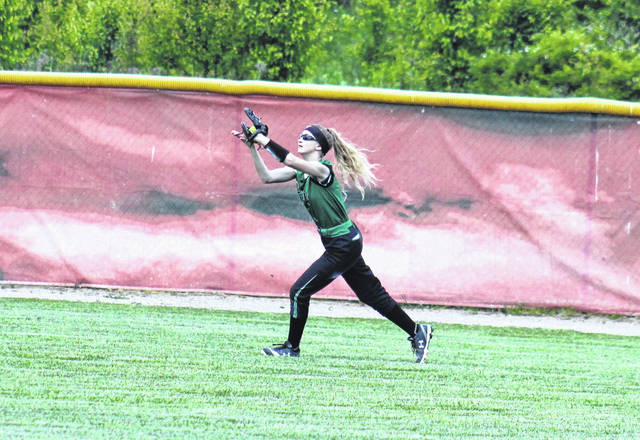 Eastern sophomore Kennadi Rockhold catches a flyball in center field, during the Lady Eagles' 9-0 setback in the district championship game on Saturday in Rio Grande, Ohio.