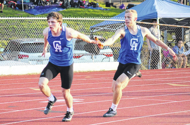 Gallia Academy's Ryan Donovsky (left) takes a handoff from Ian Hill, during the 4x200m relay at the Region 7 championships at Muskingum University on Thursday in New Concord, Ohio.