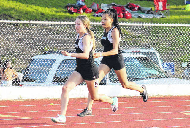 River Valley senior Rakia Penick (right) hands off to junior Savannah Reese (left) during the 4x200m relay prelim on Thursday at Muskingum University in New Concord, Ohio.