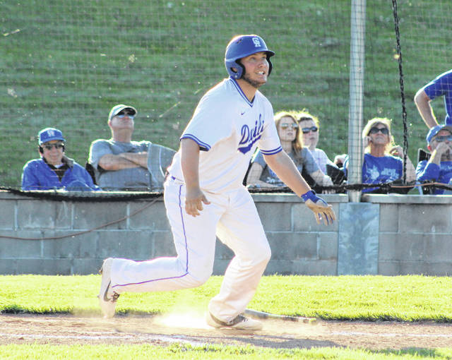 Gallia Academy senior Garrett McGuire lifts a fly ball to right field during the fifth inning of an April 22 baseball contest against Rock Hill at Bob Eastman Field in Centenary, Ohio.