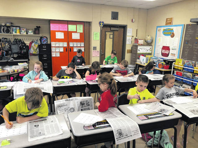 Students read donated copies of the Gallipolis Daily Tribune during Right To Read Week at Addaville Elementary.