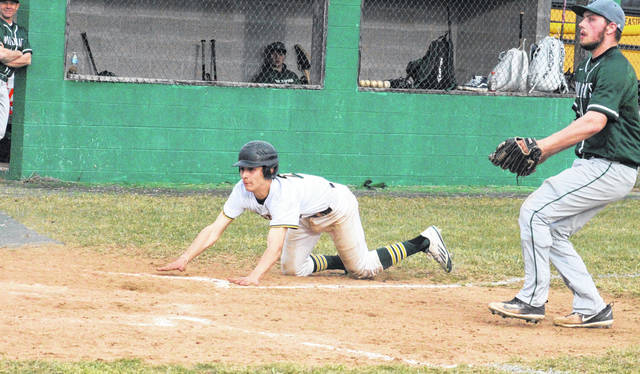 Eastern sophomore Matthew Blanchard slides safely into home plate, during the Eagles' victory over Waterford on March 29 in Tuppers Plains, Ohio.