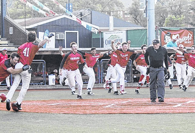 Rio Grande players rush onto the field after scoring the winning run in the bottom of the 12th inning of Sunday's 7-6 victory over Indiana University Kokomo in the championship game of the River States Conference Baseball Championship at VA Memorial Stadium in Chillicothe, Ohio.
