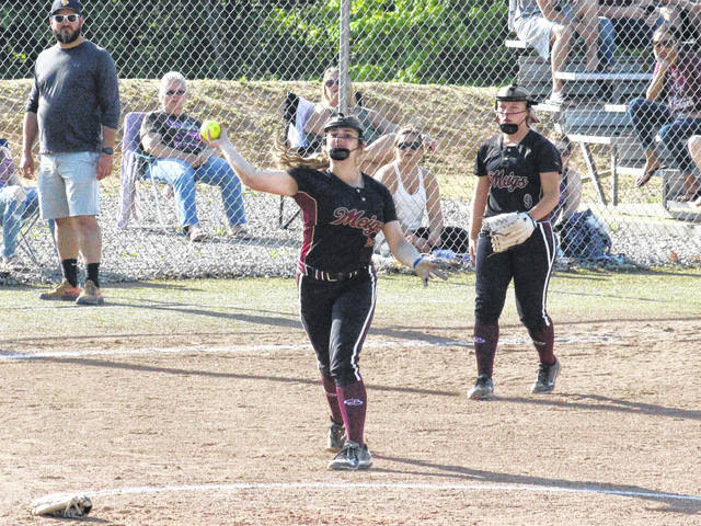 MHS pitcher Hailey Roberts throws to first base in front of third baseman Breanna Zirkle, during the Lady Marauders' 12-4 sectional semifinal victory on Tuesday in Rocksprings, Ohio.