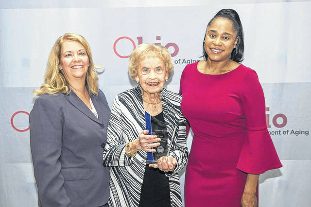 Pictured are Duana Patton, director of the Ohio District 5 Area Agency on Aging, Inc., and current president of the Ohio Association of Area Agencies on Aging (left), Marianne B. Campbell (center) with her award, and Ursel McElroy, director of the Ohio Department of Aging (right).