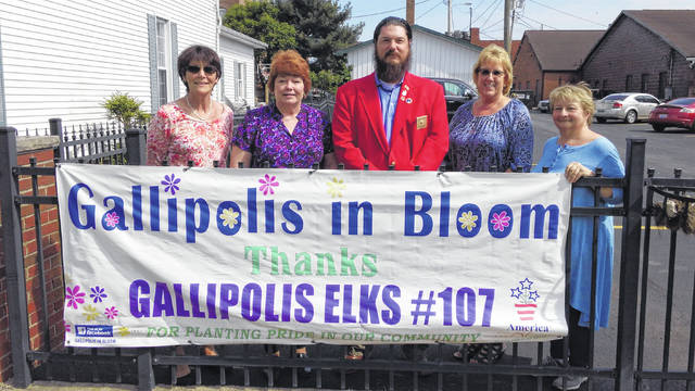Gallipolis Elks 107, in conjunction with the Elks National Foundation, donated $2,500 to Gallipolis in Bloom in support of the beautification of the City of Gallipolis on Planting Day. The money was utilized to help purchase plants, flowers and grow boxes throughout the community and downtown area. Presenting the donation is Exalted Ruler Bob McClaskey, center along with Betty Betgrow, GIB Vice-President, Diana Parks, GIB Tresurer, Kim Canaday, GIB volunteer and Cathy Waller, GIB Secretary.