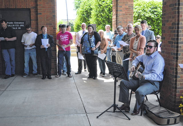 Gallia residents sing and pray at the Gallia Courthouse for National Day of Prayer. Rick Jackson led the crowd in songs My Chains are Gone and How He Loves.