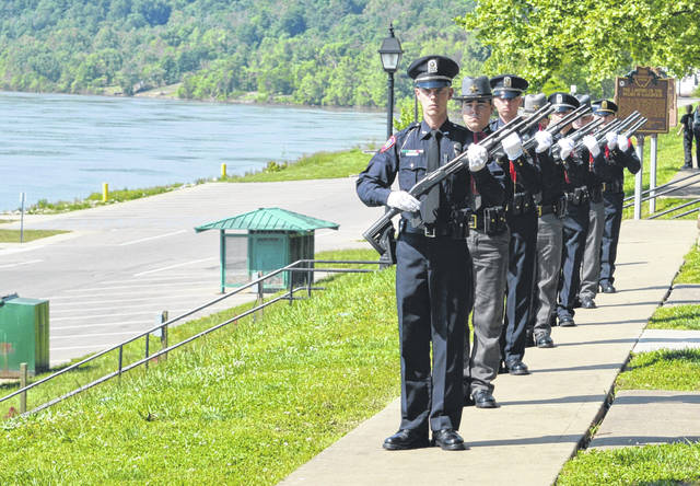 Gallia law enforcement lines up for a firing salute.