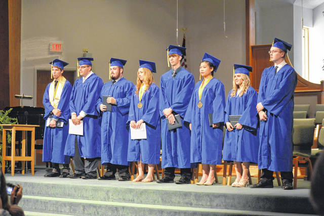 Ohio Valley Christian School seniors await the changing of the tassels during their graduation commencement.