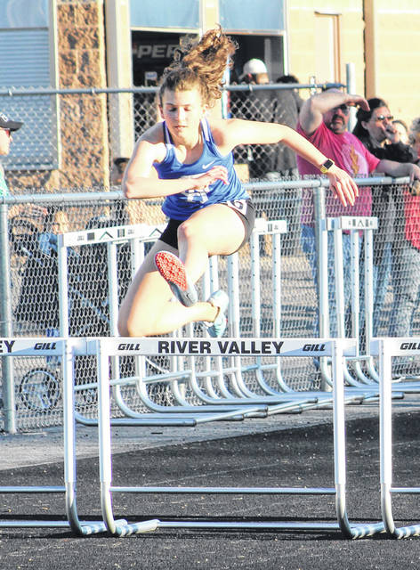 Gallia Academy freshman Gabby McConnell clears a hurdle during the 300m hurdles event at the 2019 Gallia County Meet held on April 9 at River Valley High School in Bidwell, Ohio.