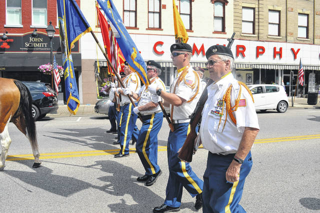 VFW 4464 Honor Guard leads the Gallia Memorial Day Parade with the colors, Monday morning. For more photos of the parade, look inside.