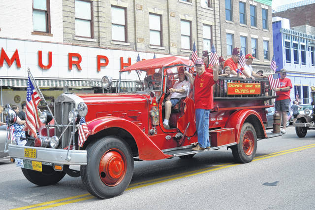 Gallipolis Shriners ride by on their traditional parade fire truck.