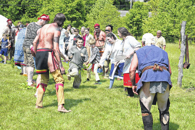 A child reenactor participating in the running of the Gauntlet in the Indian Village following the outdoor drama of the Siege of Fort Randolph in Point Pleasant on Saturday.