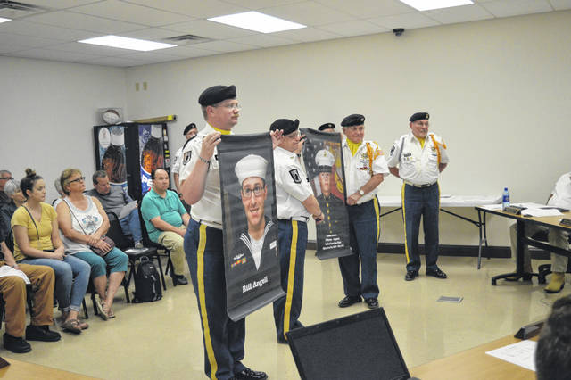 VFW 4464 Honor Guard members display banners they wish to hang from Gallipolis poles along select streets.