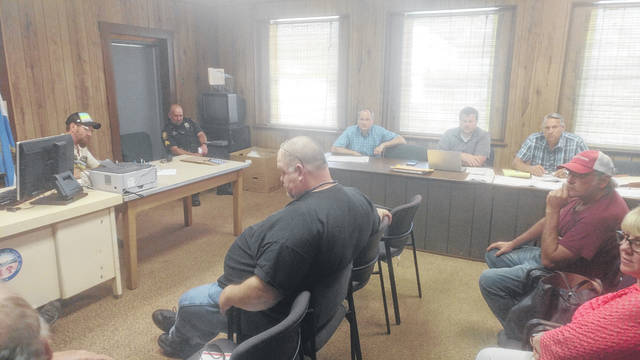 Rio Grande Village officials along with Gallia emergency officials discuss sidewalk construction plans along the Ohio 588 and Ohio 325 intersection with the Ohio Department of Transportation and contractors.