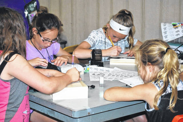 The youth at 4-H camp enjoy several different activities during their stay.