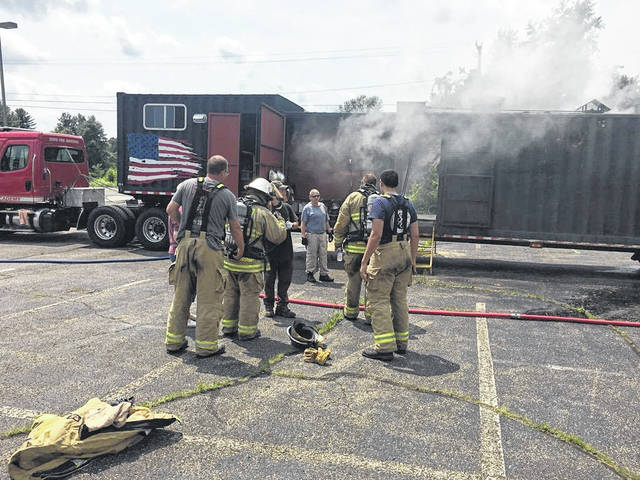 Area volunteer firefighters prepare to enter a fire behavior lab.
