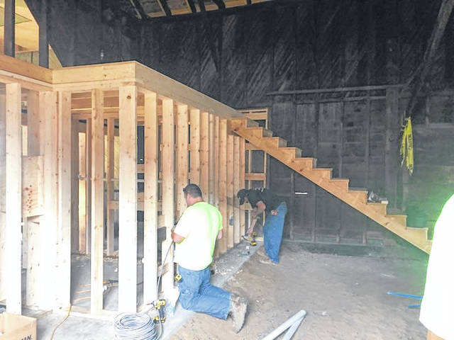 Construction crews work to establish the housing for the Gallipolis Railroad Freight Station Museum.