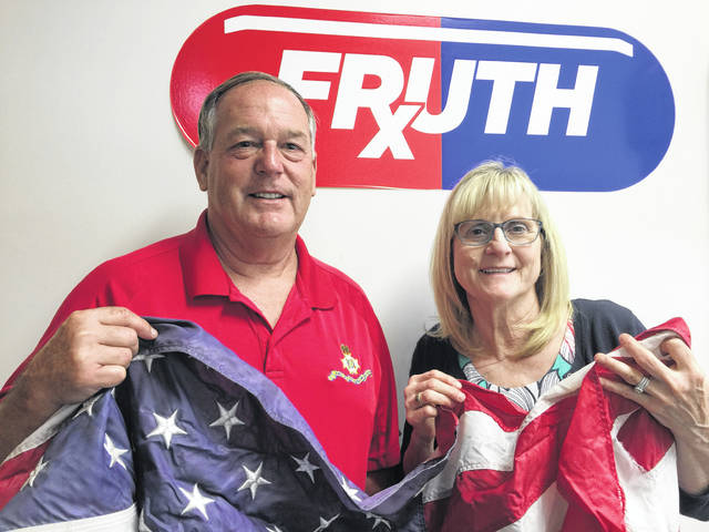 Lynne Fruth, president Fruth Pharmacy pictured alongside Ed Cromley, president of the Point Pleasant Chapter of the SAR. Fruth Pharmacy and the SAR have partnered once again for the annual flag retirement ceremony at Fort Randolph.