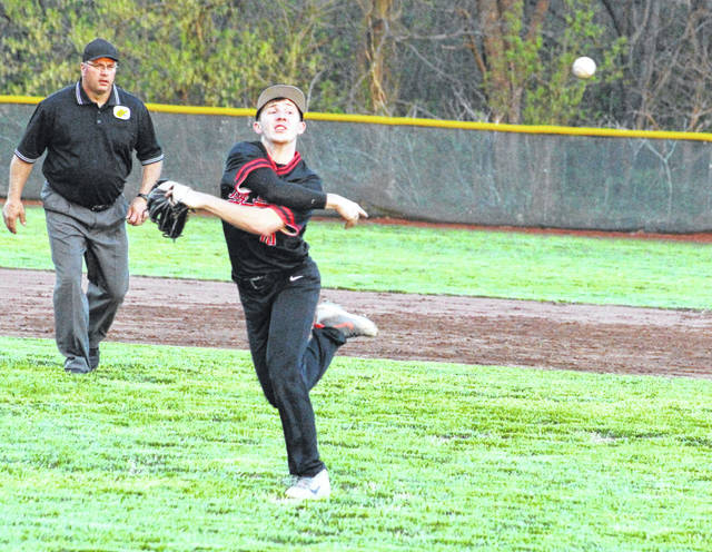 Point Pleasant senior Carter Smith releases a throw to first base during an April 16 baseball game against Poca in Point Pleasant, W.Va.
