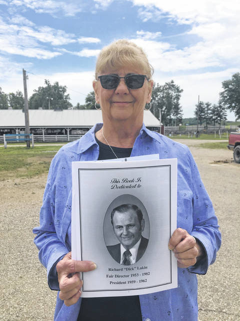 "This year the Gallia County Junior Fair dedicated the annual fair book to Richard ""Dick"" Lakin. Dick served as a fair director from 1953 to 1982 and served as President during the fairs of 1959 to 1962. Pictured above is his daughter, Becky Elliott, displaying the dedication page in the fair book."