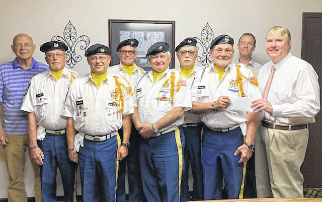 Gallia County Charitable Foundation making donation to the VFW Honor Guard 4464. Pictured left to right, front row: Brian Vance, Henry Maynard, Post Commander Bill Mangus and Gallia County Probate/Juvenile Judge Thomas S.Molton. Back row, left to right: Retired Judge D. Dean Evans, Carroll Taylor, John Watson, Rick Howell, and Attorney David C. Evans.