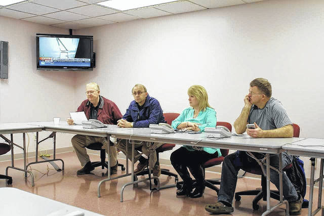 Gallia Commissioners and Gallia 911 and Emergency Management Agency Director Sherry Daines discuss an emergency declaration in 2018 for flooding in the Gallia 911 Communications Center basement.