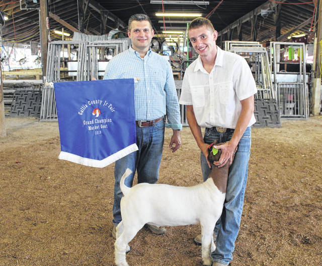 Pictured at right is Justin Butler with his grand champion market goat chosen on Monday evening by Judge Patrick Aliff, also pictured. More livestock shows are planned throughout fair week, giving young showmen like Butler opportunities to shine.