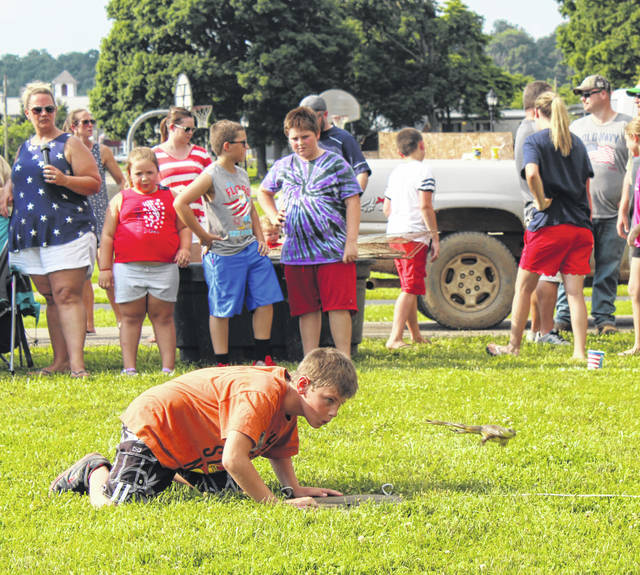 The Fourth of July was celebrated across Meigs and Gallia counties on Thursday. Pictured here, a long-time favorite in the area, the Frog Jumping Contest was held on July 4 at Star Mill Park in Racine. Organized by Council Member Ashli Peterman, the contest brought together participants of all ages. Here, Eean Bailey jumps one of his frogs. Bailey took both second and third place in the 13-17 age group. Also pictured, the fireworks display at the Gallipolis River Recreation Festival which saw City Park packed for two days of family-friendly activites. More on holiday events in Meigs and Gallia counties inside this edition and online at www.mydailytribune.com and www.mydailysentinel.com.