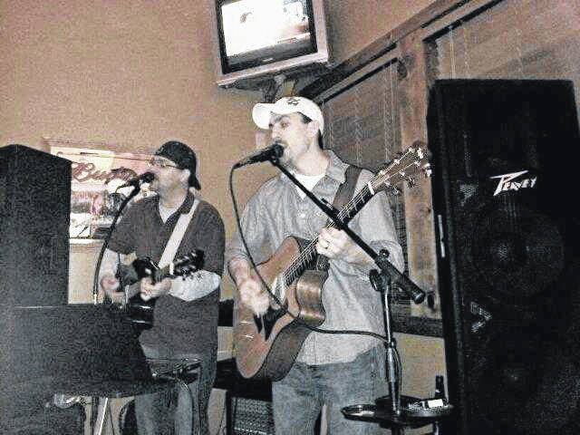 Pictured are the Stringbenders, featuring Jason Stout and Nick Rocchi. The duo performs this week at Hot Summer Nights.