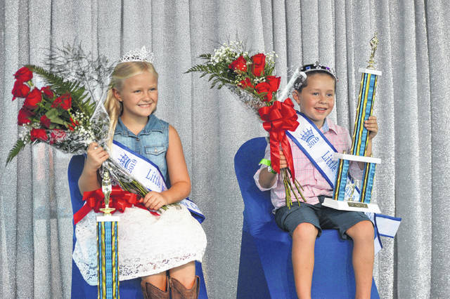 Little Miss Gallia Lydia Green sits next to Little Mister Gallia Hunter Browning during the Gallia Junior Fair Monday evening. Runner-ups included Vivienne Montgomery and Cole Washington.