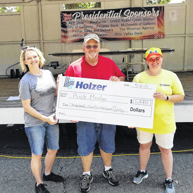 On July 4, the Duck Race saw first place winner, Rick Meaige, pictured at center, receive $1,280.