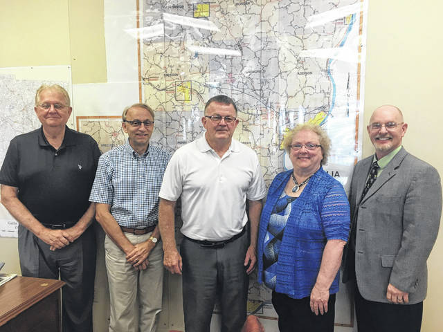 From right to left, Gallia Commissioners Harold Montgomery, David Smith and Brent Saunders stand with Gallia-Vinton ESC Superintendent Denise Shockley and Gallia County Job and Family Services Director Dana Glassburn.