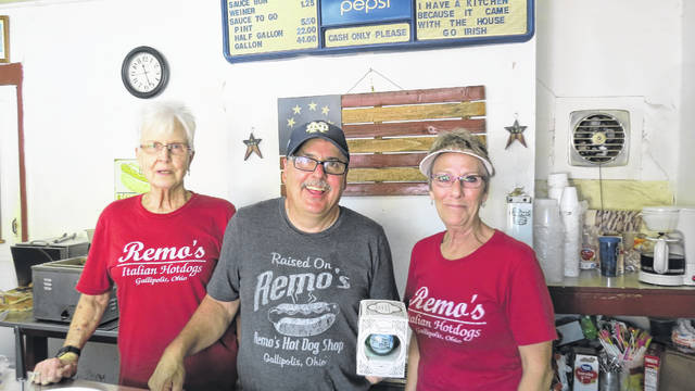 Remo's Italian Hotdogs' Loretta Johnson, Rob and Diane Gauze stand with the Gallia Historical Society's Heritage Bulb.