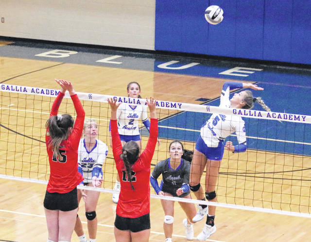 Gallia Academy senior Alex Barnes (5) leaps for a spike attempt during Game 1 of Monday night's non-conference volleyball match against Alexander in Centenary, Ohio.