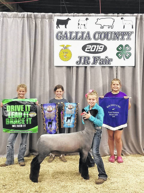 Gracyn Clark topped the sale bill with her Grand Champion Market Lamb at the Gallia County Junior Fair.
