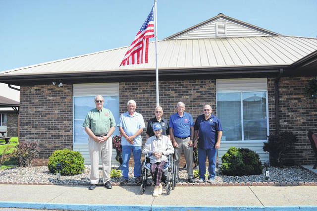 The Gallia Veterans Service Commission board members stand with retired World War II Navy veteran and Abbyshire Place resident Kermit Fisher.