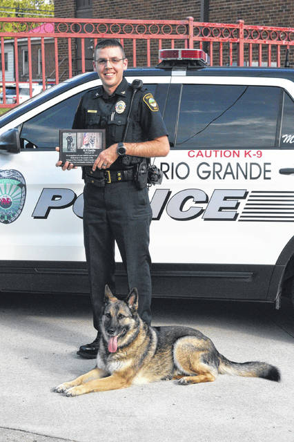 Rio Grande Police Chief Josh Davies stands with partner and retired police canine, Smilla.