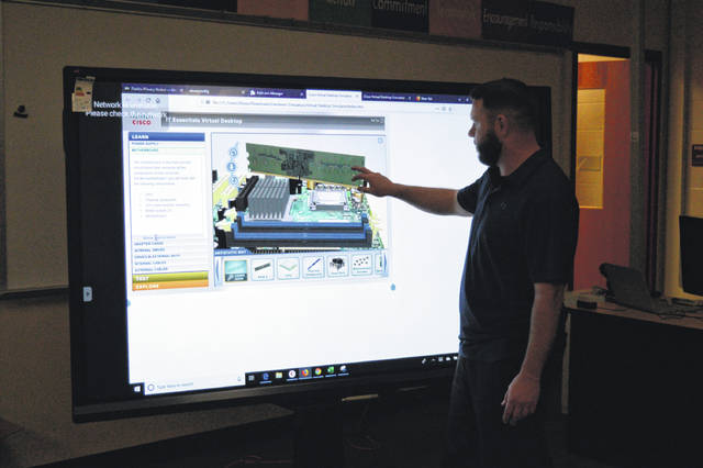 Buckeye Hills Cybersecurity Instructor Shawn Northup utilizes some of the career center's teaching equipment.
