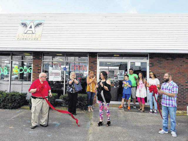 Earlier this month, the Gallia County Chamber of Commerce held a ribbon cutting for Angel's Furniture in celebration of its Grand Opening. Angel Halley, owner of Angel's Furniture, welcomed guests and provided hot dogs and hamburgers to community and business members. Gallipolis City Commissioner Tony Gallagher addressed the public and welcomed the new business to the City of Gallipolis. Halley's friends, family, and staff were in attendance, as well as Chamber Board member Rick Jackson (The Wiseman Agency) and Chamber staff Elisha Orsbon. Also attending to support their fellow Chamber member, Dave Diddle (93.1 The Wolf), Autumn Thomas (Thomas Do It Center) and Jennifer Rose (Edward Jones). Angel's Furniture is located at 1616 Eastern Avenue, Gallipolis, Ohio. Current business hours are 10 a.m. to 6 p.m., Monday through Saturday, closed on Sunday. Find them on Facebook. Pictured is a scene from the ribbon cutting.