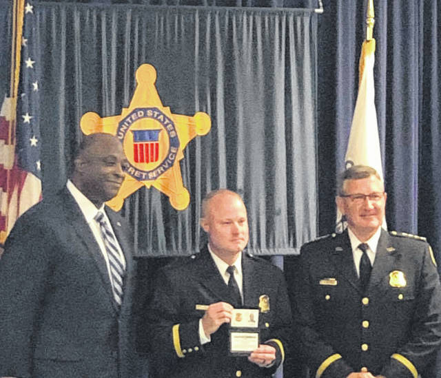 Former Gallia Sheriff's Deputy Andrew Holcomb receives his U.S. Secret Service Commission, Friday, in Washington D.C.