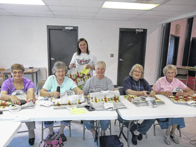 "Pictured are the ladies of the First Church Of The Nazarene working on ""hunger bags."""